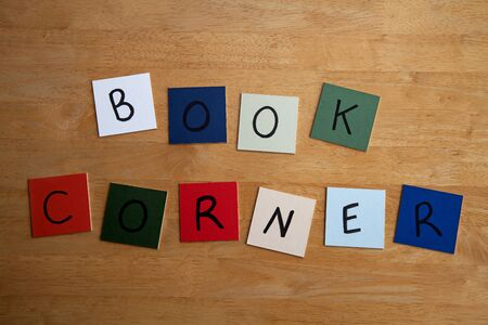 BOOK CORNER  written on color tiles for The Arts, Teaching, Libraries, Reading and Writing Stock Photo - 17501341