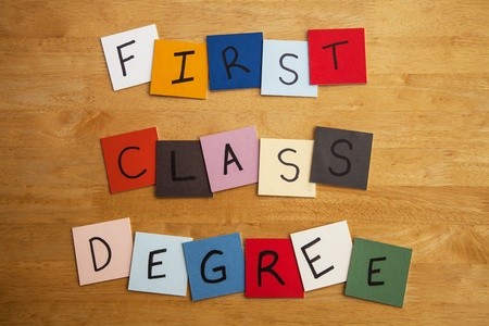 FIRST CLASS DEGREE  written on color tiles for University, Educational, Editorial, Teaching, Lecturing Stock Photo - 17492377