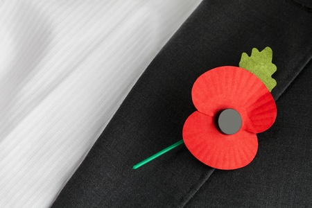 Poppy on jacket lapel, for Poppy Day or Remembrance Sunday  photo