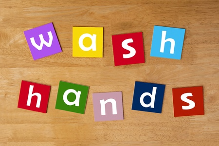 junior education: wash hands - sign in lower case letters for school children - education   learning  Stock Photo