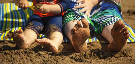 sandcastles: Bare feet and Sand at Beach - panorama