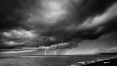 Lightning Storm Over Sea - black and white photo