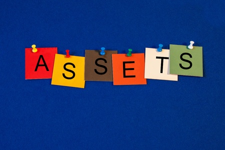 Assets - sign series for business - letters and tiles with pins, on noticeboard