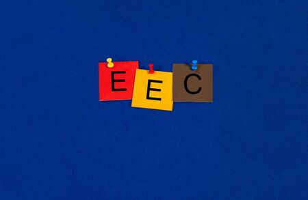eec: E.E.C. - Business and PR terms sign series, tiles and letters on noticeboard with pins.