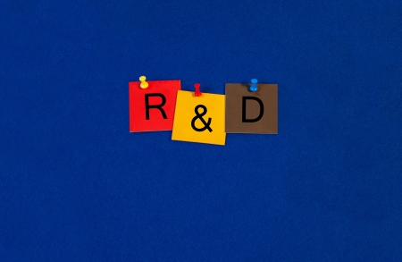 rd: R&D - Business and Research sign series, tiles and letters on noticeboard with pins.