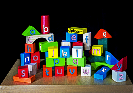 a - z for children on building bricks - each letter of the alphabet spelt once photo
