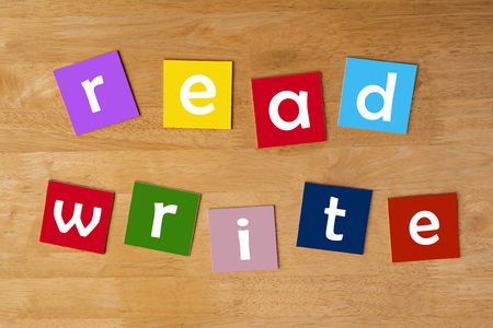 read, write - word sign for school children - lower case letters for education & learning. photo