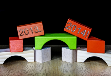 new year's resolutions: 2013 fading into 2014 for a New Year - crossing over the bridge - concept for New Years resolutions and old to a new start Stock Photo