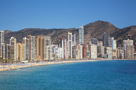 Benidorm town, sea and Playa de Levante under sunny blue skies, Costa Blanca, Spain