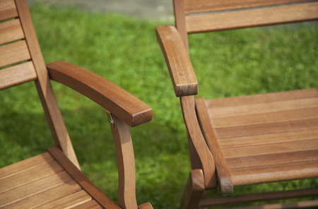 Summer garden furniture close up - concept for relaxing in the warm climate and summers here. Focus on the chair arm, with text space. Stock Photo