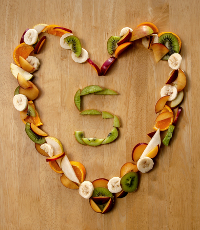 nutrition and health: Healthy Heart ...?! Eat 5 a Day fresh fruit n veg to maintain a good heart and health - for nutrition, health care and a good diet. Stock Photo