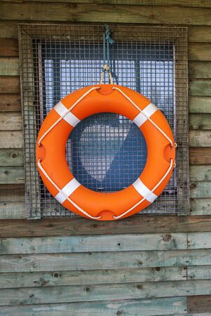 watersports: Life Ring or Life Buoy on Hut, symbol for watersports and water safety, with text space.