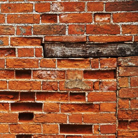 plinth: Brick wall background, square with wooden plinth and red bricks. Stock Photo