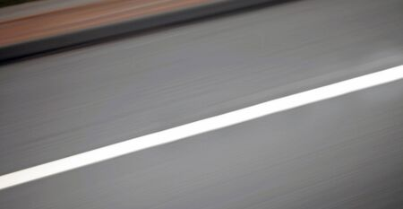 kerb: Urban highway  road speed backgrounds - panorama of blurred street and kerb, blurred for motion effect.