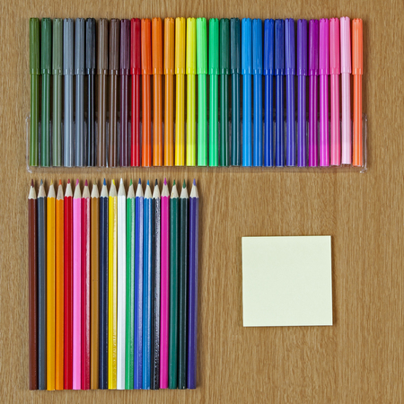 notelet: Educational or Art background, art crayons and felt tips, with text space.