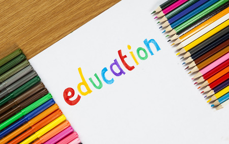 felt tip: Education sign written, with felt tip and pencil crayons, with text space.