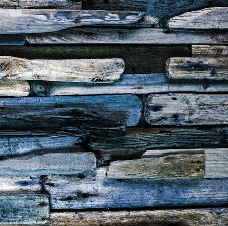 square composition: Blue driftwood -  imaginative background texture, worn paint and rugged wood grain, square composition. Stock Photo