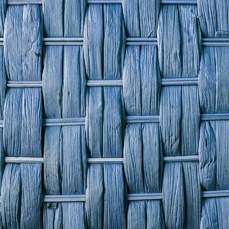 crisscross: Imaginative blue woven reed  wood abstract background texture.