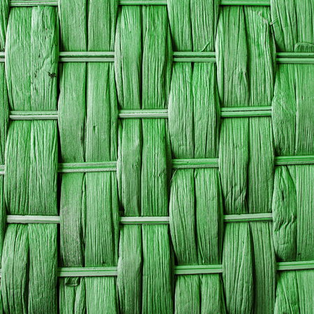 criss: Imaginative green woven reed  wood abstract background texture.