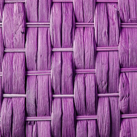 criss: Imaginative pink woven reed  wood abstract background texture.