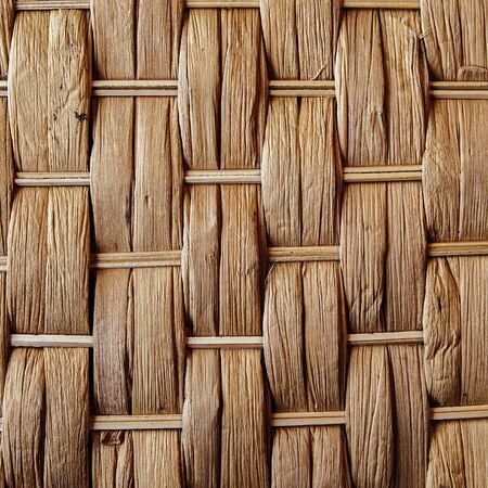 criss cross: Woven reed  wood - abstract background texture.