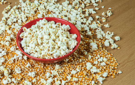 bowls of popcorn: Bowl of Popcorn, with unpopped corn too - copy  text space.