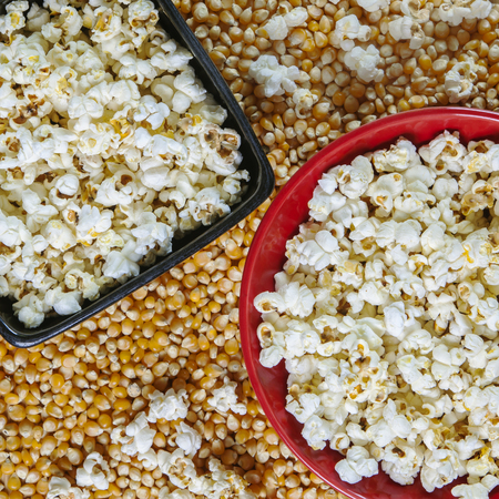 popcorn bowls: Popcorn snacks in bowls on bed of corn.