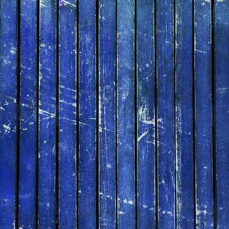 beaten up: Wonderfully beaten up, scratched and scuffed bright blue wooden  planks  timber - vintage, abstract background texture, with peeling paint on wood.