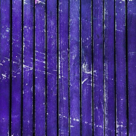 beaten up: Wonderfully beaten up, scratched and scuffed purple wooden  planks  timber - vintage, abstract background texture, with peeling paint on wood.
