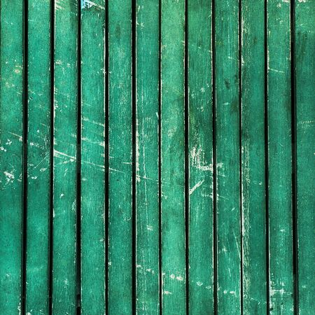 scuffed: Wonderfully beaten up, scratched and scuffed turquoise wooden  planks  timber - vintage, abstract background texture, with peeling paint on wood. Stock Photo