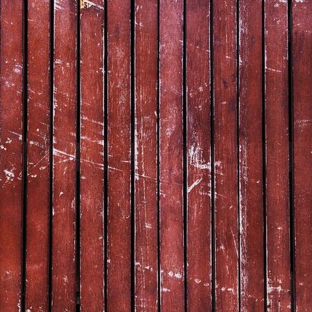 scuffed: Wonderfully beaten up, scratched and scuffed wooden  planks  timber - vintage, abstract background texture, with peeling paint on wood.