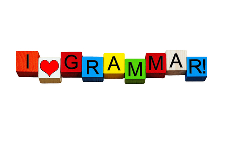 verbs: I Love Grammar - sign for education, teaching, English language, linguistics, vocabulary, nouns, adverbs, verbs & punctuation - design in bold letters, isolated on white background. Stock Photo