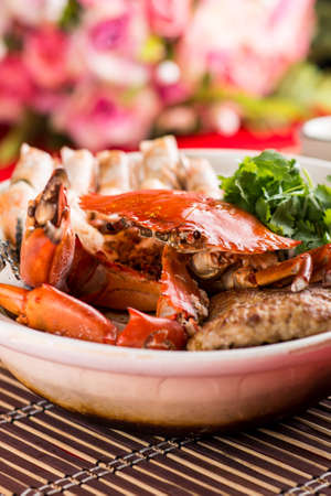 Claypot seafood bowl 龙虎烩 with crab, prawn and spices Stock Photo