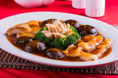 Braised Sea Cucumber with mushroom and fish maw Stock Photo
