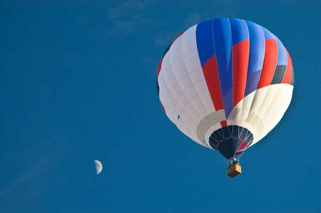 Hot Air Balloon in the blue sky with moon