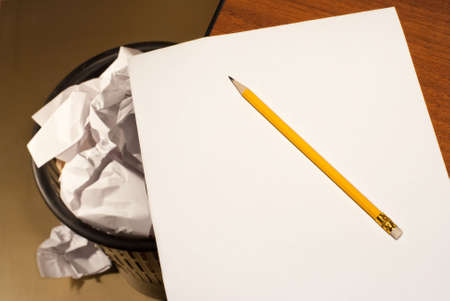 Yellow pencil  on a white paper