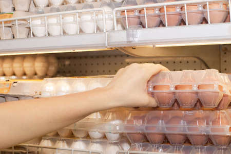 Buying �ggs in a supermarket Stock Photo