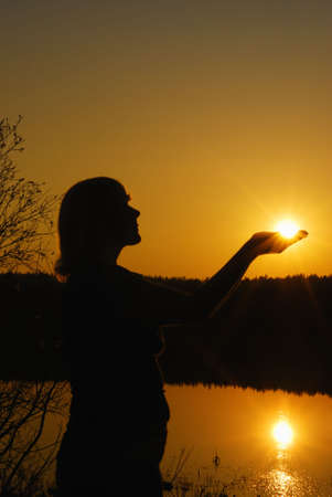 Silhouette woman with  sun in  hands Stock Photo - 4781192