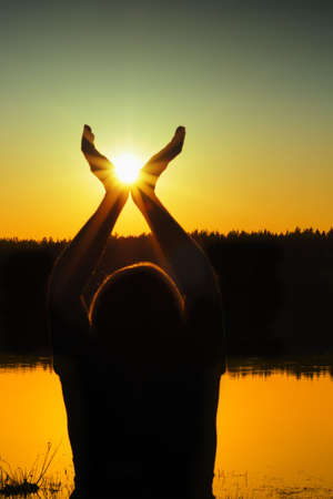 Silhouette woman with  sun in  hands Stock Photo - 4803454