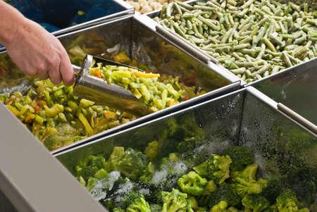 Buying frozen vegetables in  supermarket