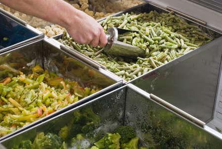 Buying frozen green beans in  supermarket Stock Photo
