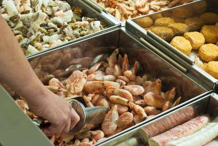 Buying frozen shrimps in  supermarket Stock Photo