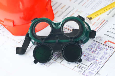 Construction protective glove with helmet and roulette photo