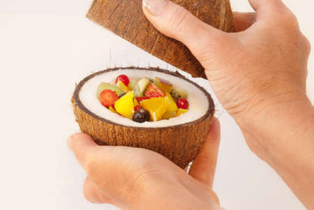 Tropical fruits and berries placed in the coconut