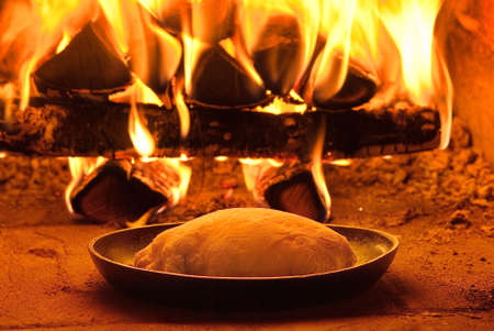 Traditional baking bread in an old stone oven photo