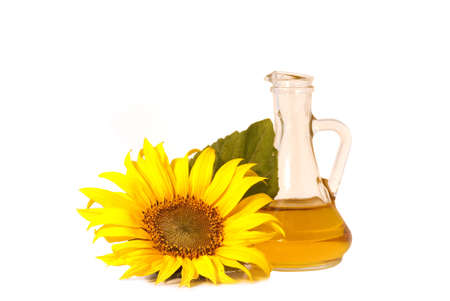 Sunflowers and oil   isolated on white background Stock Photo - 5321149