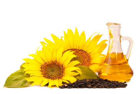 Sunflowers, oil and seeds  isolated on white background