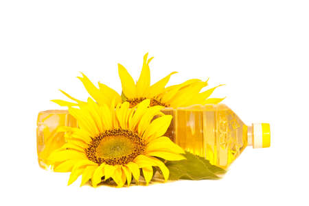 Sunflowers and oil  isolated on white background Stock Photo - 5321160