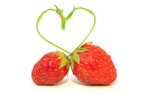 The composition of two strawberries with  stalk in form of heart
