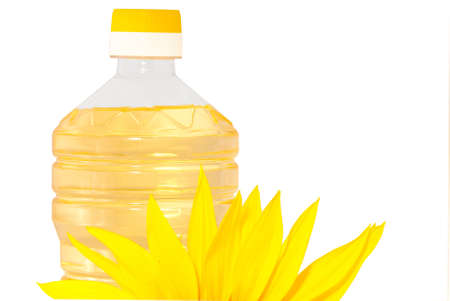 Sunflowers and  bottle with sunflower oil isolated on white background Stock Photo - 5408211
